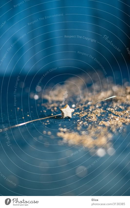 A golden star on a blue glittering background; Christmas, Advent, decoration Christmas & Advent Gold New Year's Eve Glittering Stars Star (Symbol) Starry sky