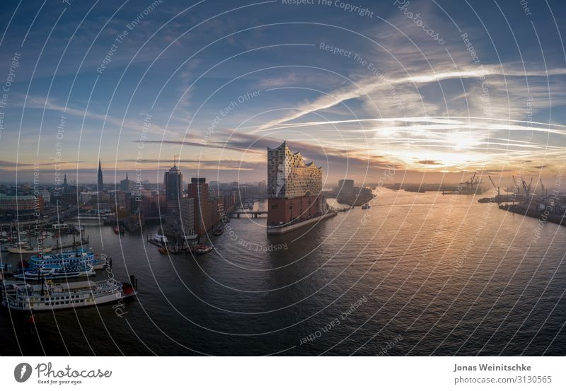 Elbphilharmonie with Hafencity at sunrise Port City Manmade structures Architecture Tourist Attraction Landmark Monument Elbe Philharmonic Hall Navigation
