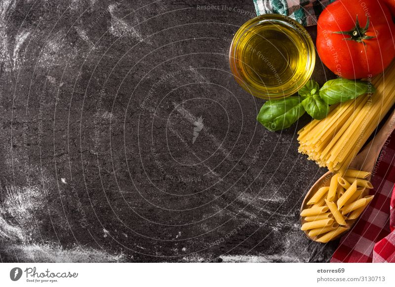 Italian pasta and ingredients. Food Healthy Eating Tomato Vegetable Spaghetti Macaroni Fresh Cooking oil Ingredients Red Basil Diet Green Meal White Raw Salad
