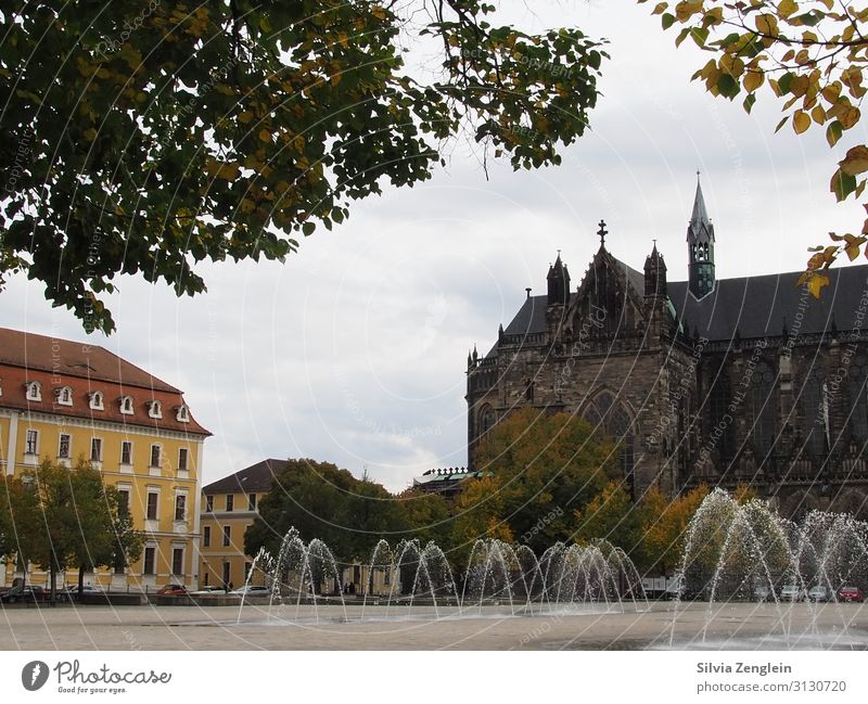 cathedral square Tourism Trip Sightseeing City trip Architecture Water Drops of water Town Capital city Downtown Church Dome Places Fountain Tourist Attraction