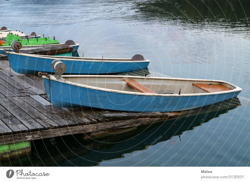 Fishing boats on the shore of the lake Beach Blue Watercraft Calm Coast Dusk Fisherman Fishing (Angle) Lake Leisure and hobbies Nature Natural Old Exterior shot