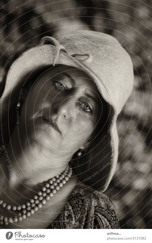 Boredom under a hat Woman Hat Necklace Earring Madame Earnest Elegant Weary Lady Looking into the camera Sepia lady's hat Pearl necklace Chain Adults bored
