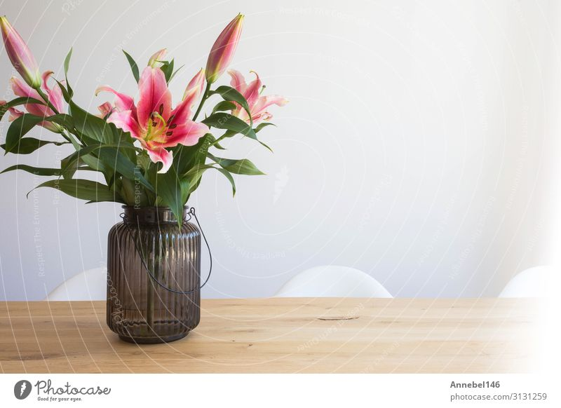 pink lily flowers in a vase on a wooden table Elegant Design Beautiful Summer Flat (apartment) Garden Decoration Table Nature Plant Flower Leaf Blossom