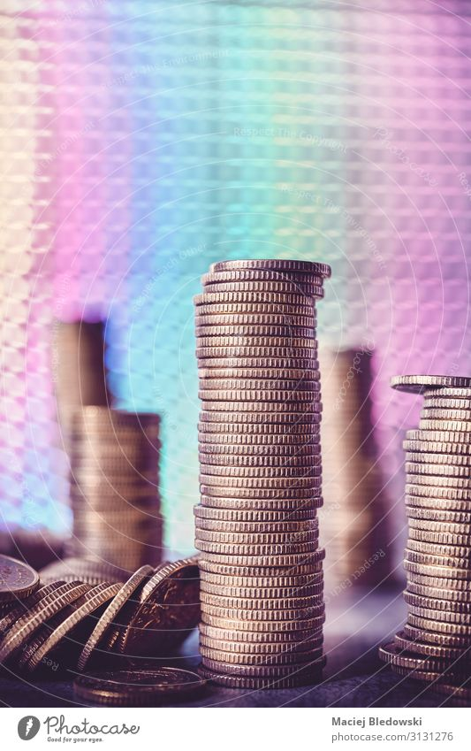 Stacks of golden coins against a disco style background. Lifestyle Shopping Luxury Happy Money Night life Party Success Economy Financial Industry