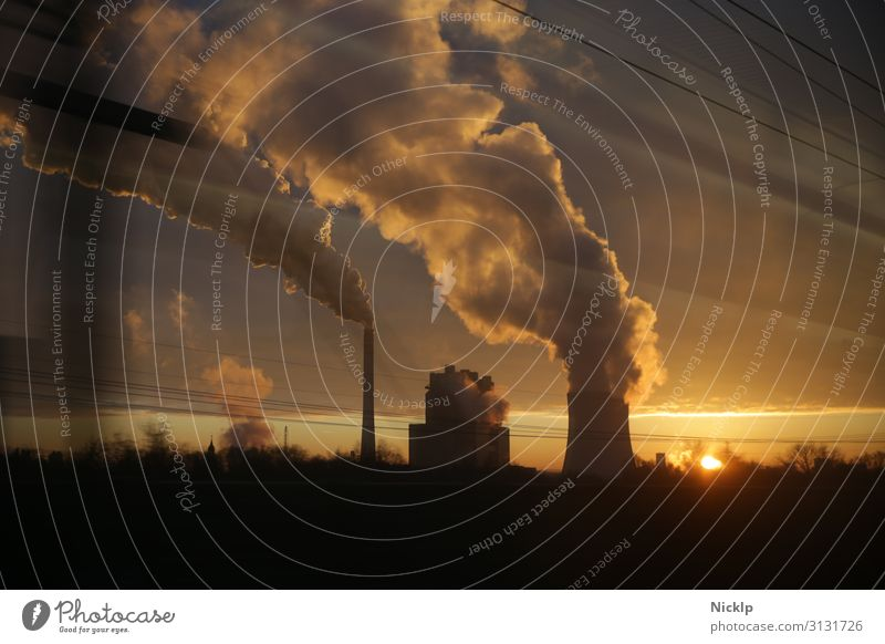 Smoke from a coal-fired power station near Leipzig, Germany against the sunset Coal power station Climate change CO2 emission Air pollution Energy Economy