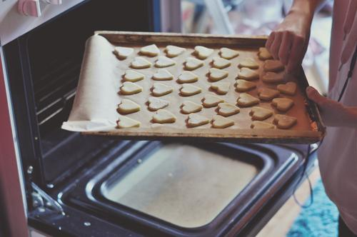 Off to the oven Cookie Christmas biscuit Baked goods Baking Stove & Oven Baking tray Sweet Candy Christmas & Advent Hot push in Kitchen Cooking Human being Hand