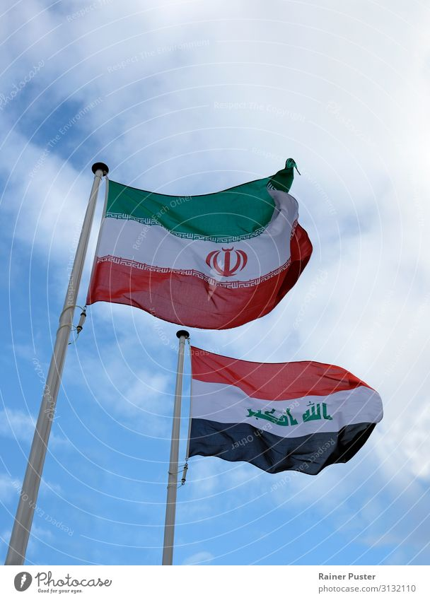 The national flags of Iran and Iraq against a blue sky Tehran Near and Middle East Landmark Flag Ensign Blue Green Black White Attachment Colour photo