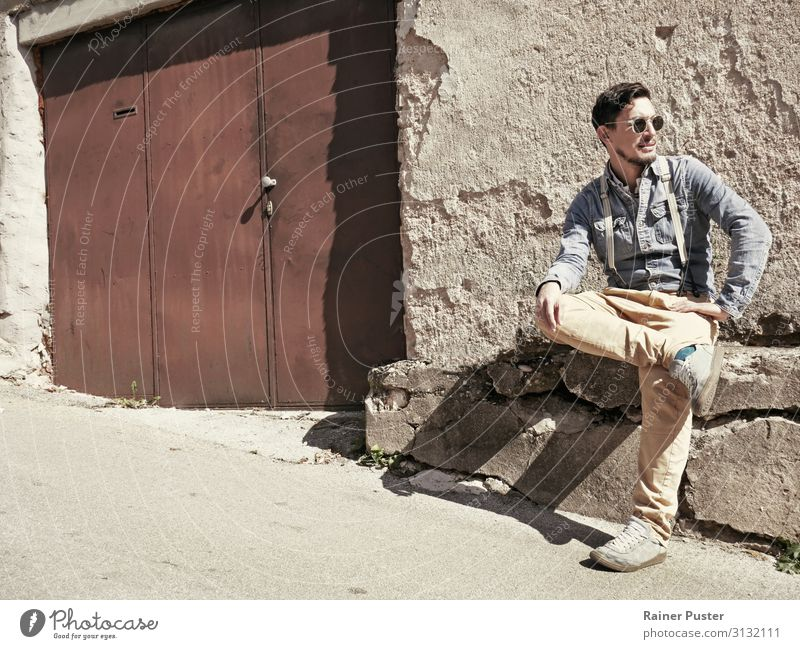 Man with sunglasses and suspenders in the sun Masculine Adults 1 Human being 30 - 45 years Sarajevo Bosnia-Herzegovina Ruin Pants denim shirt chino Sunglasses