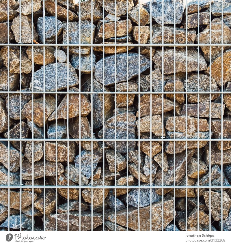 Stone wall with metal grid Wall (barrier) Wall (building) Esthetic Background picture Garden Border Metal Real estate Boundary line Structures and shapes
