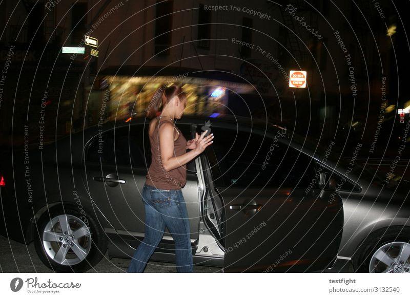 Do not enter Feminine Transport Street Vehicle Dark Get in Car Door Motion blur Colour photo Exterior shot Copy Space top Night Flash photo