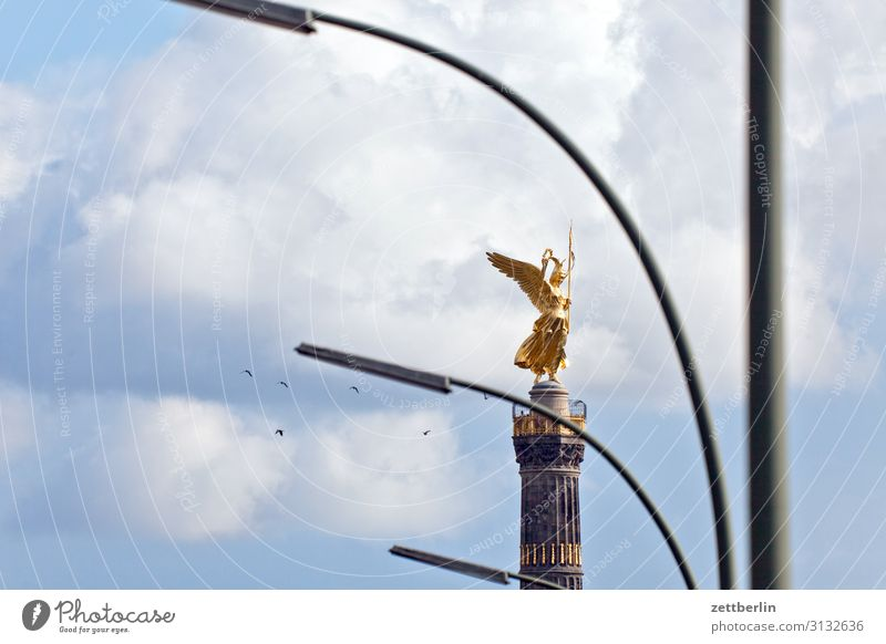Victory column with lanterns and birds Monument else Goldelse victory statue Victoria big star Berlin zoo Park Forest Downtown Berlin Germany Figure leaf gold