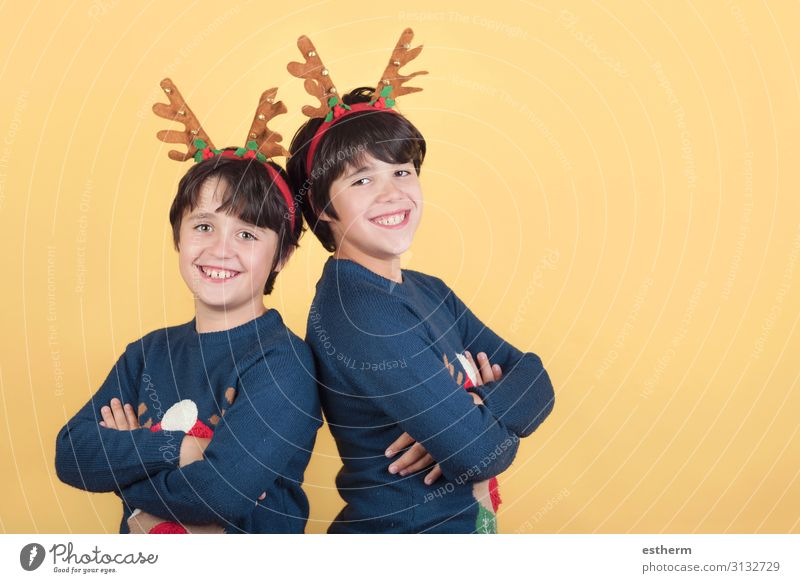 smiling children in a Rudolph Reindeer christmas costume Joy Winter Feasts & Celebrations Christmas & Advent New Year's Eve Human being Masculine Child