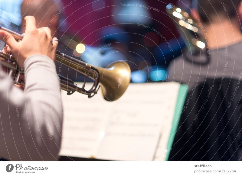 trumpet solo Human being Masculine Arm Hand 3 Music Listen to music Concert Stage Band Musician Orchestra Trumpet Trumpeter Trombone Musical notes Sheet music
