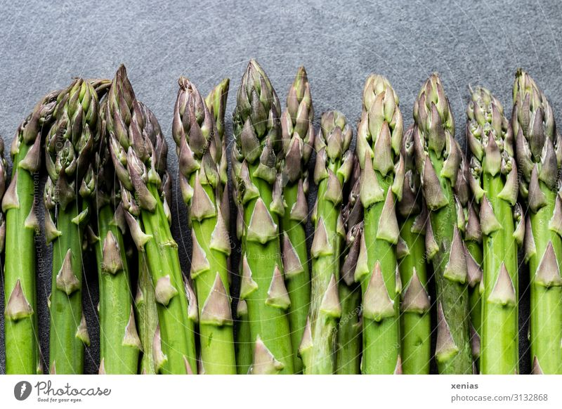 green asparagus on grey worktop Asparagus Green Food asparagus spears Vegetable Nutrition Organic produce Vegetarian diet Diet Spring Fresh Healthy Long