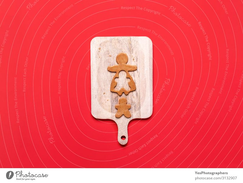 Gingerbread girl cookie and little boy cookie. Christmas concept Christmas & Advent White Winter Candy Tradition Dessert Cookie Baking Chopping board December
