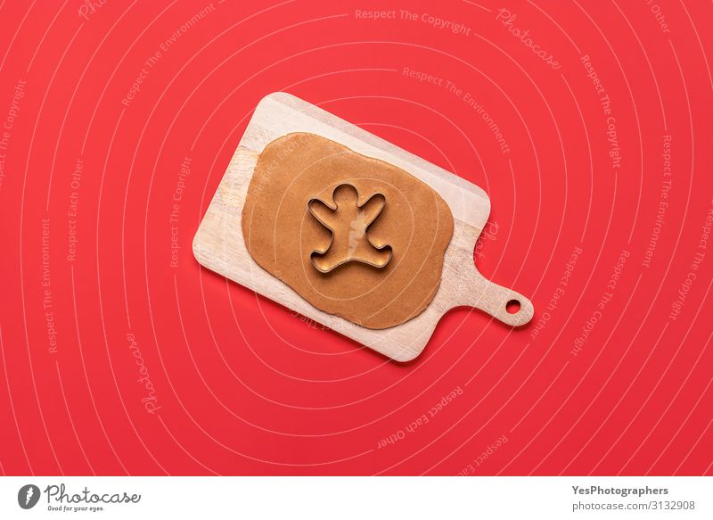 Gingerbread man cookie cutter and dough on red background Christmas & Advent White Winter Feasts & Celebrations Copy Space Happiness Delicious Candy Cake
