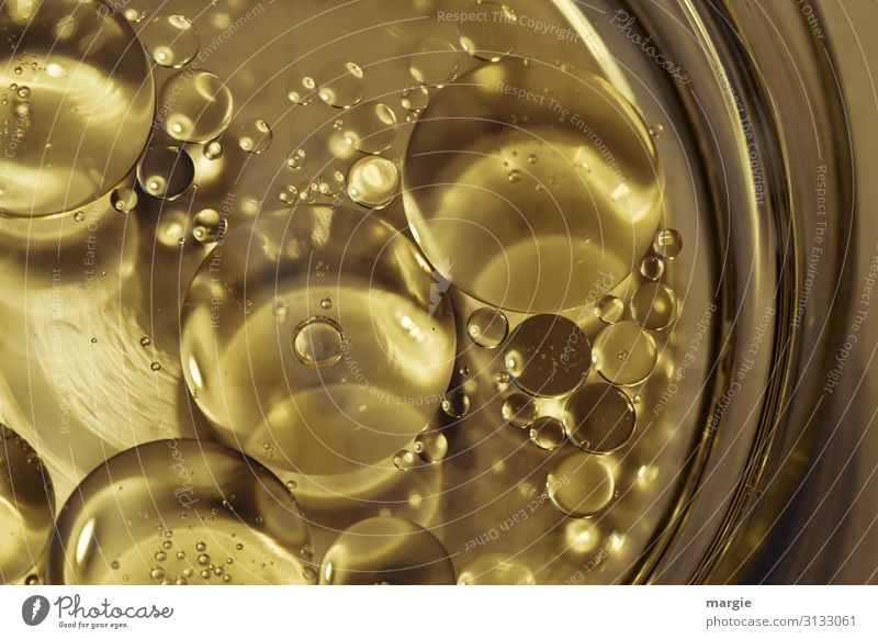Liquid with bubbles in gold Food Cooking oil Crockery Plate Bowl Glass Gold Chemistry Chemical compound Chemical elements Bubble Drop Fluid Luxury Air Fantasy