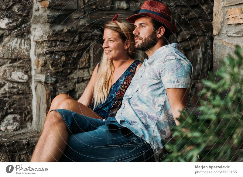 Young couple sitting on the stairs in an old village Lifestyle Joy Vacation & Travel Tourism Summer Summer vacation Human being Masculine Feminine Young woman