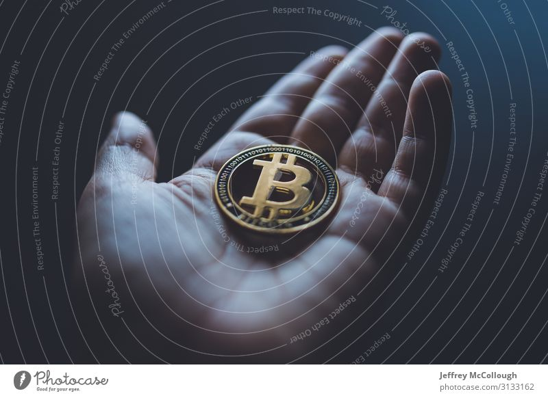 Holding a bitcoin Hand Fingers Coin Token Metal Money Cryptocurrency Shopping Investor investment Gold savings Save cash Colour photo Interior shot Close-up
