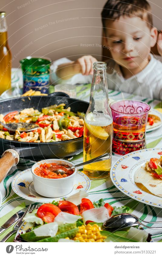 Pan with mexican food on a table Vegetable Eating Dinner Beer Table Restaurant Child Human being Boy (child) Man Adults Group To enjoy Authentic Hot Delicious