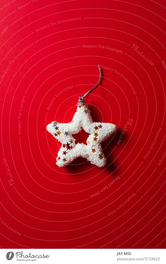 Shiny white Christmas star on red background, minimal concept Winter Decoration Feasts & Celebrations Christmas & Advent Collection Ornament String Glittering