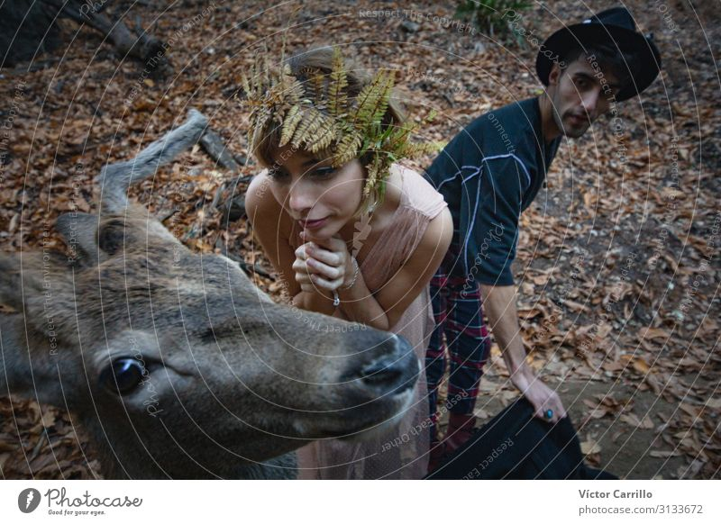 A young blonde boho woman and a young man with a deer Lifestyle Elegant Style Exotic Human being Masculine Feminine Young woman Youth (Young adults) Young man
