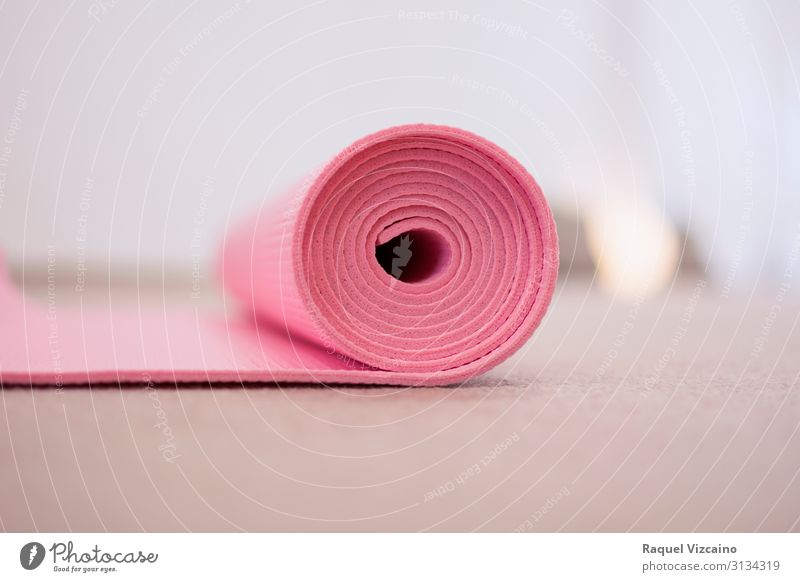 "Pink yoga mat, rolled up. Lifestyle Wellness Sports Yoga Cloth White Peaceful Self Control Colour Contentment ""pink isolated equipment colorful sport object"