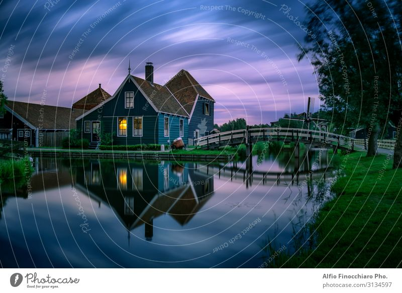 Windy and cloudy sunset in Zaanse Schans Lifestyle Vacation & Travel Tourism City trip Summer vacation House (Residential Structure) Culture Environment Nature