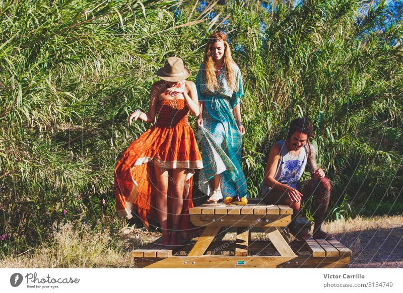 A group of two young boho styled women and a man Lifestyle Joy Happy Beautiful Relaxation Tourism Summer Beach Woman Adults Friendship Youth (Young adults)