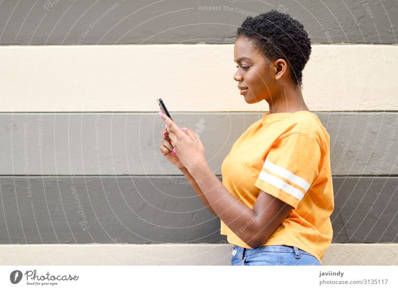 Young black woman using her smart phone outdoors. Lifestyle Style Happy Hair and hairstyles Telephone Cellphone PDA Technology Internet Human being Feminine