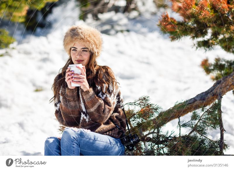 Young woman enjoying the snowy mountains in winter Coffee Tea Lifestyle Elegant Happy Beautiful Face Leisure and hobbies Winter Snow Mountain Human being