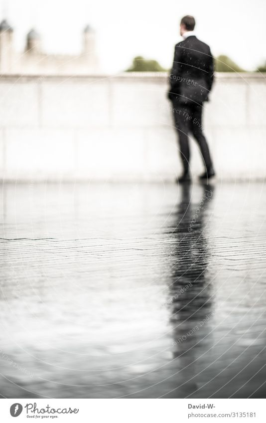 leave someone out in the rain - businessman out in the rain... on the wet street his shadow is reflected Businessman Man Work and employment Human being Suit