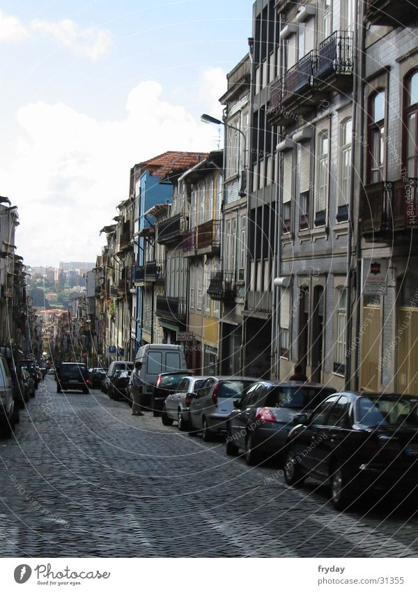 postage Portugal Urban canyon Vanishing point Europe Porto Street Mountain parked cars