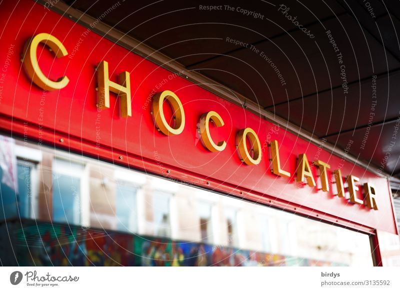 chocolate shop Candy Chocolate Shopping Craft (trade) Store premises Storefront Shop window Characters Company sign To enjoy Authentic Positive Sweet Town