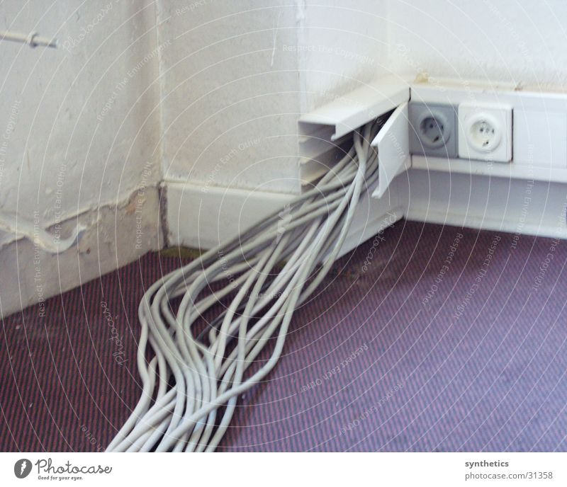 tangled cables Cable Wall (building) Electrical equipment Technology cable duct Sockets!