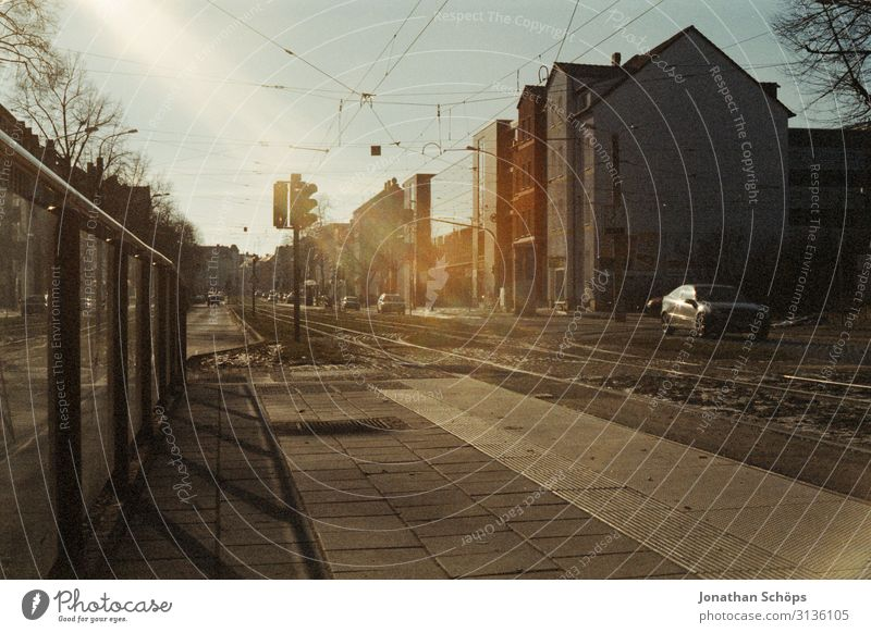 Footpath and tram tracks in Erfurt Tram lines Railroad tracks Town Analog movie Scan Sun Old Former ahus urban car Traffic light Fence Boundary off Concrete