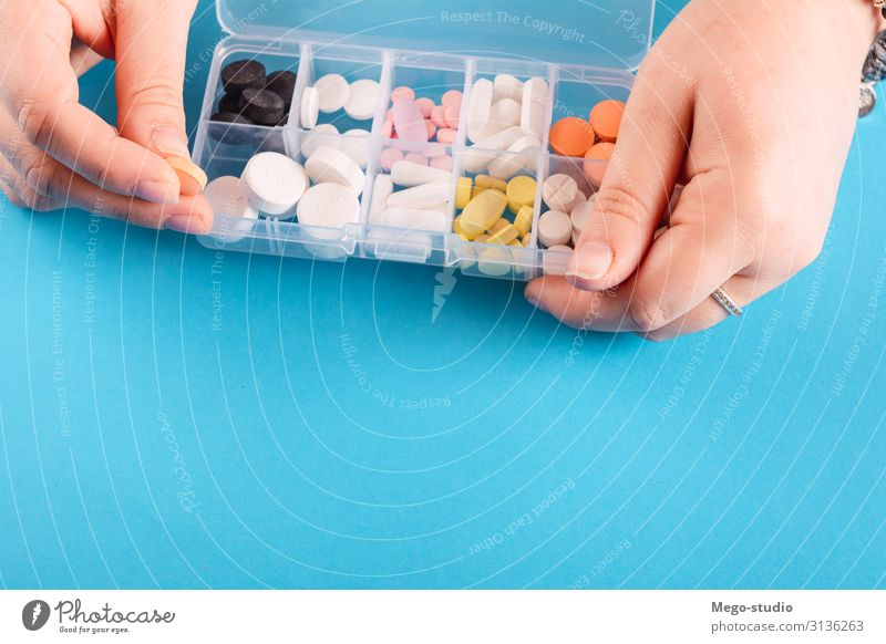 hand showing medicine box with pills Health care Medical treatment Illness Medication Hand Newspaper Magazine Container Box White antibiotic Capsule days