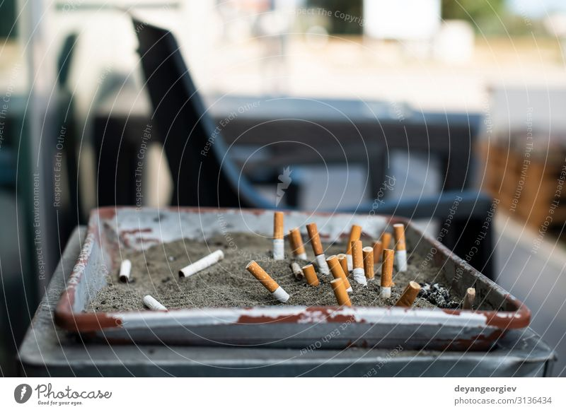 Ashtray with sand and buried cigarettes. Sand Dirty Cigarette Butt smoking area Conceptual design Public stop Cancer Ashes filter health smoke Lung Trash