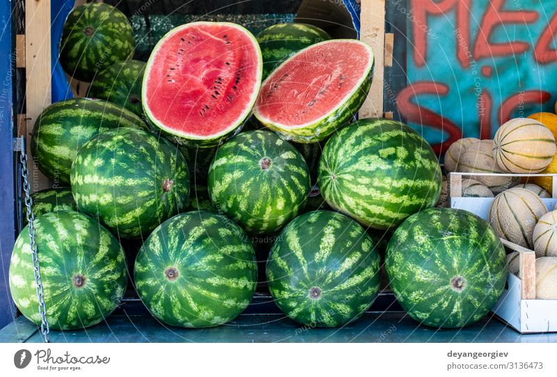 Watermelons on shelf. Cutted watermelon on street market Food Fruit Nutrition Diet Shopping Summer Marketplace Fresh Delicious Natural Juicy Red Water melon