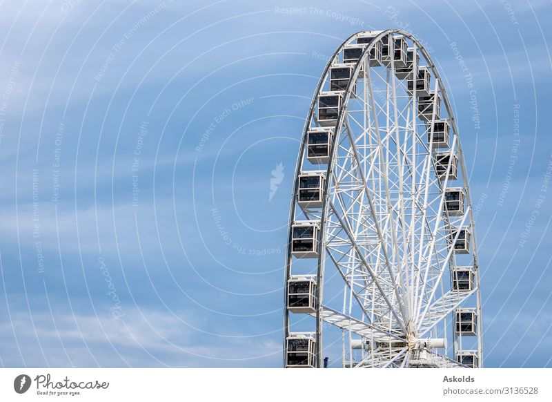 Panoramic wheel on a light blue sky background. Joy Beautiful Relaxation Vacation & Travel Tourism Sightseeing Summer Entertainment Landscape Sky Park Skyline