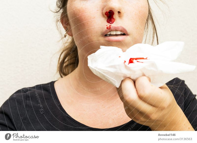 Wound nosebleed, woman bleeding from her nose Body Skin Face Health care Illness Medication Relaxation Human being Woman Adults Mouth Drop Small Red White Pain