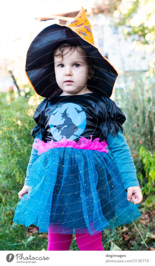 A little girl with a Halloween costume. Joy Happy Feasts & Celebrations Hallowe'en Child Infancy Autumn Dress Hat Dark Small Black Horror Tradition Witch