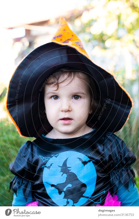 A little girl with a Halloween costume. Child Joy Dark Black Autumn Happy Feasts & Celebrations Small Infancy Tradition Dress Hat Hallowe'en Magic Guest October