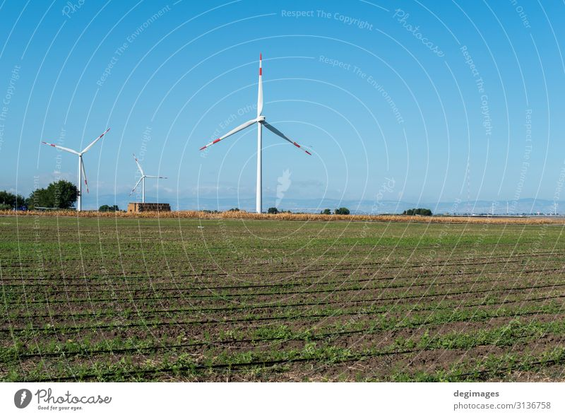 Wind generator and agricultural land. Industry Technology Wind energy plant Environment Nature Landscape Sky Sustainability Blue Green Energy Renewable field
