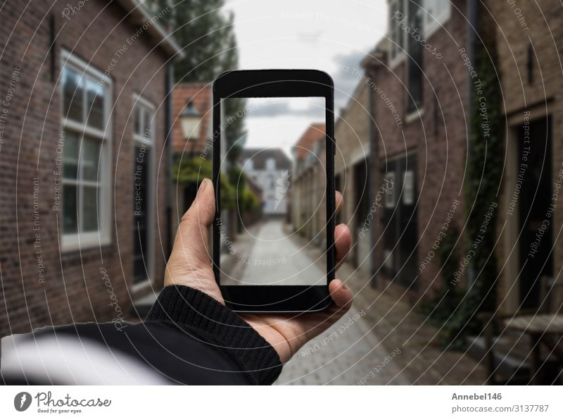 Hand holding the black smartphone with blurred screen Woman Man White Black Adults Business Decoration Modern Technology Fingers Photography Illustration