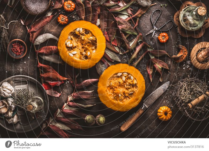 Halved pumpkin with seeds on dark kitchen table Food Nutrition Organic produce Vegetarian diet Diet Crockery Style Design Healthy Eating Table Restaurant
