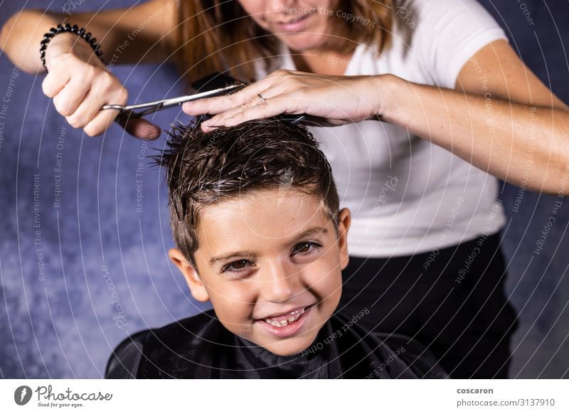 Beautiful boy getting a haircut with scissors Woman Child Human being Youth (Young adults) Blue White Joy Black 18 - 30 years Lifestyle Adults Funny