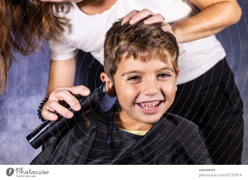 Little boy getting a haircut with a cutting machine Woman Child Human being Youth (Young adults) Blue Beautiful White Black 18 - 30 years Face Lifestyle Adults