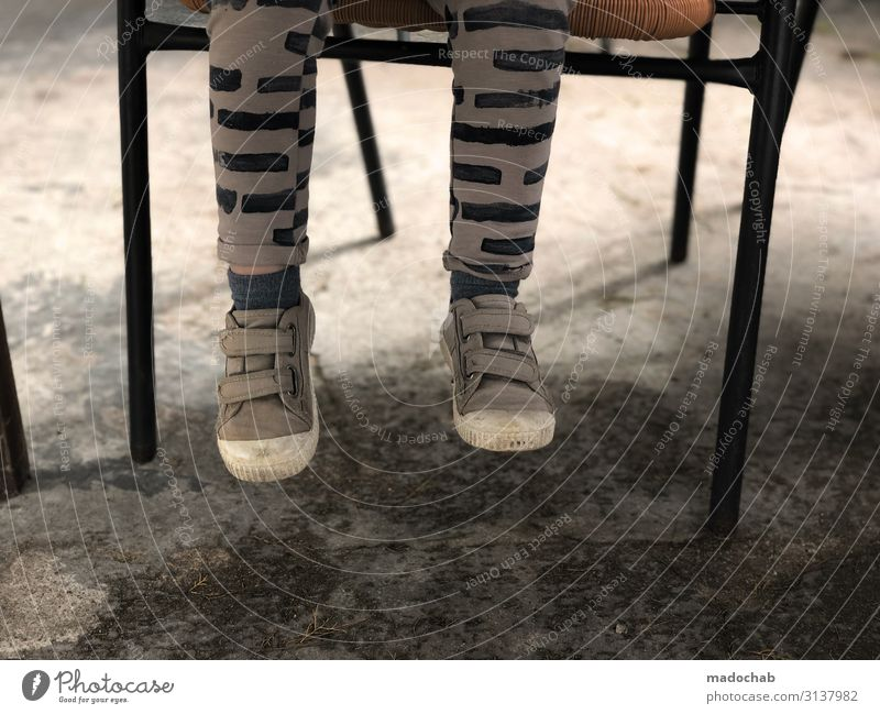Too short Lifestyle Human being Child Toddler Legs Feet 1 Sit Wait Trashy Loneliness Break Footwear Dangle Chair Colour photo Subdued colour Exterior shot