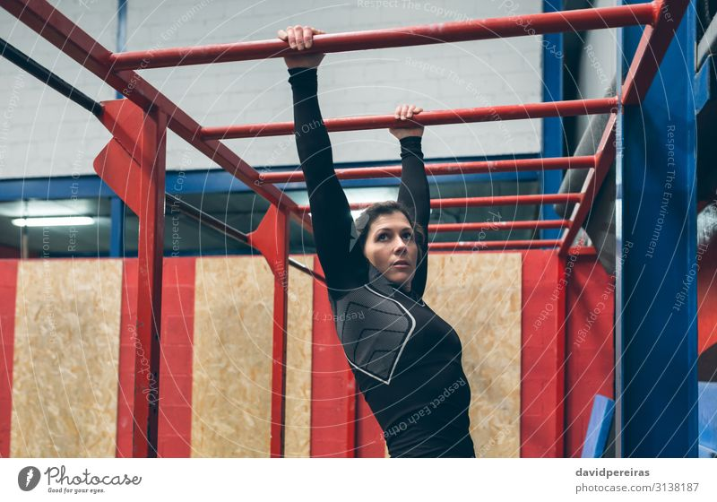 Sportswoman exercising on monkey bars Lifestyle Beautiful Body Human being Woman Adults Brunette Fitness Athletic Authentic Strong Gymnasium Monkeys